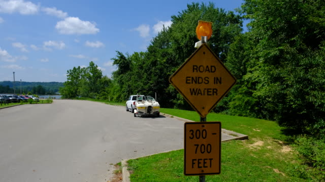 a sign warns drivers that the road ends in water at paynetown boat ramp at monroe lake sunday august 16 near bloomington indiana a car was driven... - boat ramp stock videos & royalty-free footage