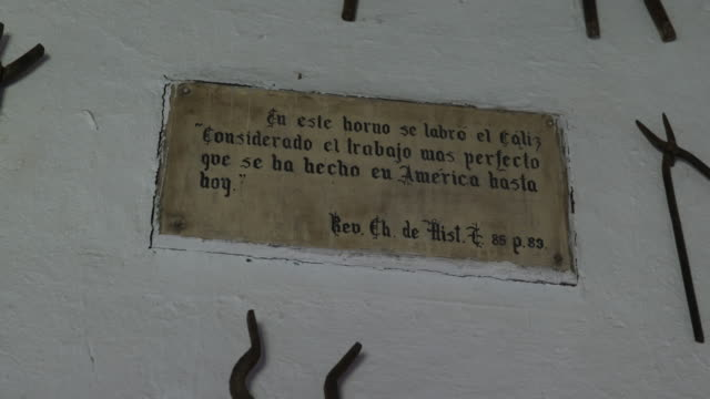 sign with a handwritten quote in spanish on a wall on a property in calera de tango chile which were used by german jesuit brothers calera de tango... - jesuit stock videos and b-roll footage