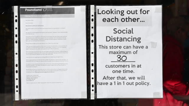 a sign with information on social distancing in the window of a store on march 28 in cardiff wales the coronavirus pandemic has spread to many... - information sign stock videos & royalty-free footage