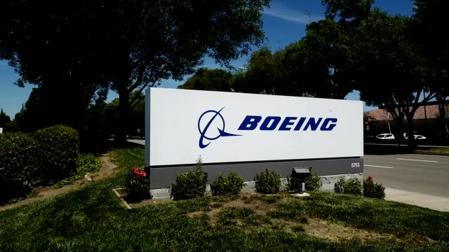 sign with logo at entrance to office of aerospace company boeing in pleasanton california 2019 - boeing stock videos & royalty-free footage