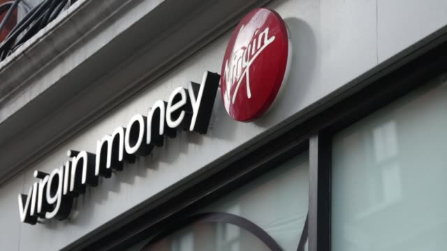 sign with logo sits on an automated teller machine , operated by virgin money holdings plc, outside a bank branch in london, u k, on monday, nov 17... - plc stock videos & royalty-free footage