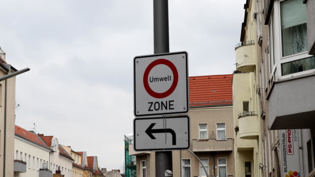 Sign with the inscription Environment zone which means that some older cars are not allowed to enter this area taken in Neukölln in Berlin at the...