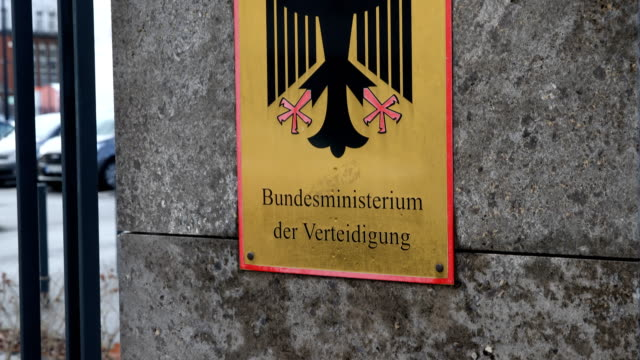 stockvideo's en b-roll-footage met sign with the inscription federal ministry of defense and coat of arms of germany entrance of the federal ministry of defence on january 28 2019 in... - ministerie van defensie