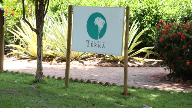 a sign with the logo of instituto terra at the garden of the institute's headquarter on november 22 2019 in aimorés brazil twenty years ago this land... - ranch logo stock videos & royalty-free footage
