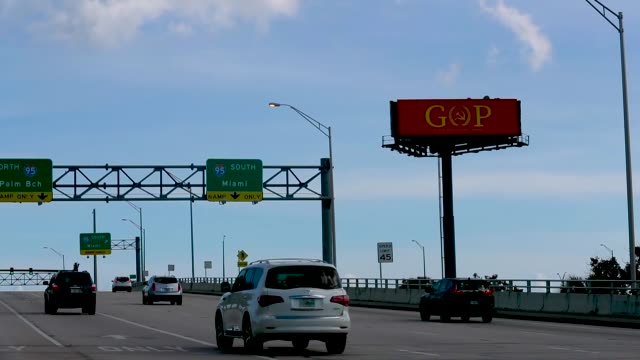 """a sign with the words """"gop"""" and the """"o"""" fashioned in the shape of a hammer and sickle topped by a star which mimics the former soviet union's flag is... - sickle stock videos & royalty-free footage"""