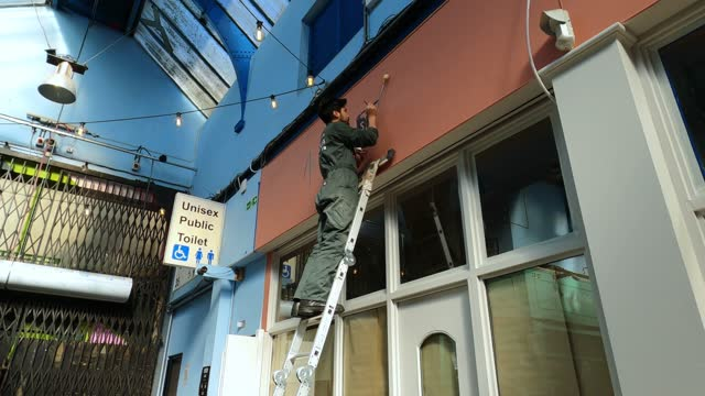 sign writer kit tinkler works on a new sign as businesses in brixton village prepare for a relaxation of lockdown restrictions on march 09, 2021 in... - relaxation stock videos & royalty-free footage