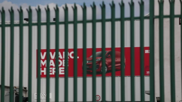 signage and advertisements of vauxhall factory in luton. general views of vauxhall motors ltd. plant in luton, bedfordshire, united kingdom, on... - wall building feature stock videos & royalty-free footage