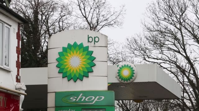 stockvideo's en b-roll-footage met bp signage and logo at a bp gas station operated by bp plc in hornchurch fuel nozzles sit ready for use at a bp gas station operated by bp plc in... - bp