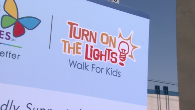 signage at the heidi klum jamie lee curtis join children's hospital los angeles for 5k walk street party lighting ceremony at los angeles ca - children's hospital stock videos & royalty-free footage