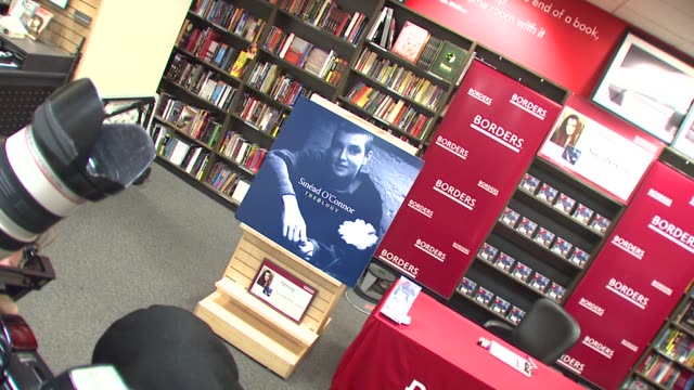 vídeos y material grabado en eventos de stock de signage at the in-store appearance by sinead o'connor signing her new religious-themed 2-disc album 'theology' at borders books & music at the time... - borders books