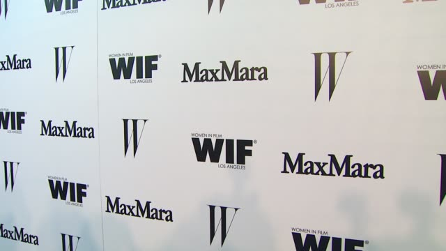 vídeos de stock e filmes b-roll de signage at the max mara and w magazine cocktail party to honor the women in film max mara face of the future award recipient, rose byrne at chateau... - rose byrne