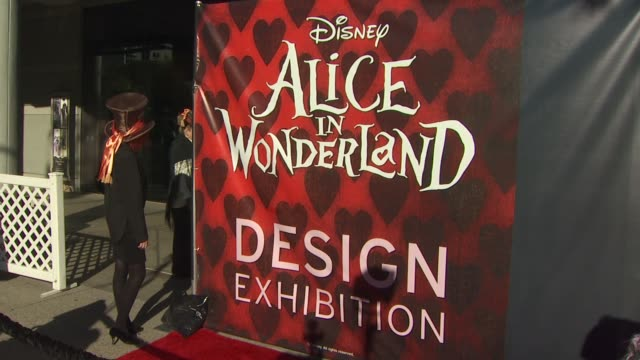 signage at the opening night of fidm exhibit for walt disney studios 'alice in wonderland' at los angeles ca - alice in wonderland stock videos and b-roll footage