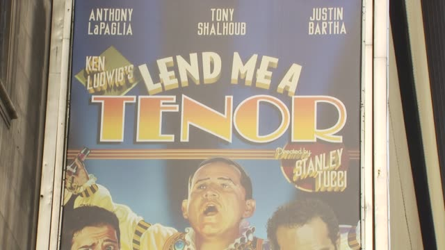 signage at the opening of 'lend me a tenor' arrivals at new york ny - lend me a tenor stock-videos und b-roll-filmmaterial