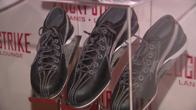 vídeos de stock, filmes e b-roll de signage at the puma x lucky strike bowling shoe launch at new york ny. - sapato de boliche