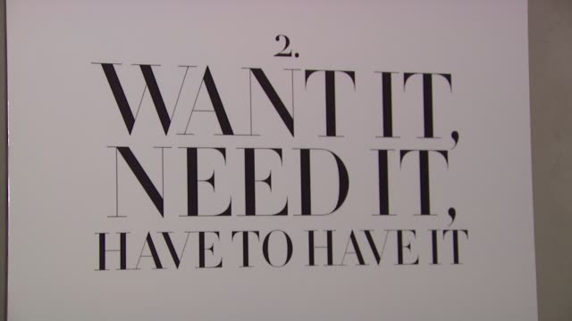 signage at the swarovski and eric daman host fete for 'you know you want it' style book at new york ny. - signierstunde stock-videos und b-roll-filmmaterial