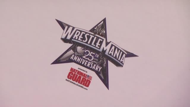 Signage at the WrestleMania 25th Anniversary Press Conference at New York NY