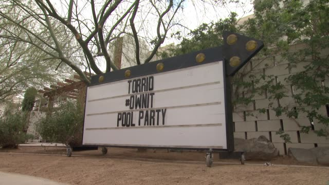 signage at torrid #ownit pool party at the commune ace hotel at ace hotel on april 09 2016 in palm springs california - palm springs california pool stock videos & royalty-free footage