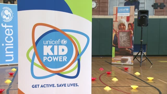 ATMOSPHERE signage at UNICEF Kid Power Kicks off in New York with Former New York Knicks Star John Starks and Oday Aboushi at PS 242 on March 25 2015...