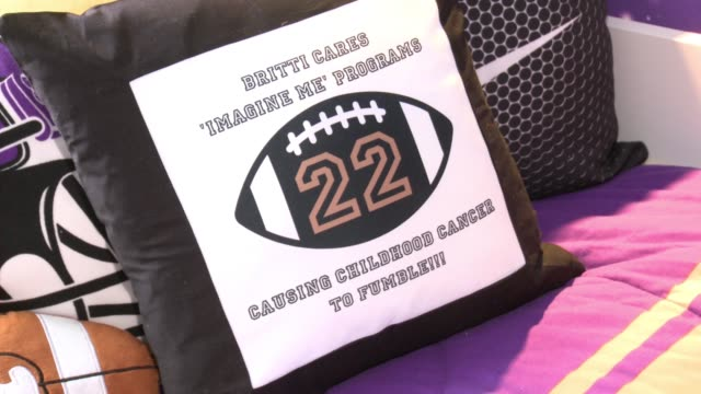 ATMOSPHERE signage at Young Boy Gets FootballThemed Room Makeover With Surprise Visit From Comedian Kevin Hart And Vikings Safety Harrison Smith...