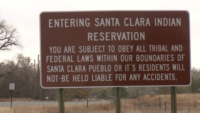 entering indian reservation santa clara pueblo day school senior center and neon welcome - native american reservation stock videos & royalty-free footage