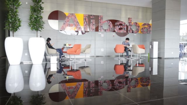 Signage for Alibaba Group Holding Ltd is displayed at a reception desk at the Alibaba Group Holding Ltd headquarters in Hangzhou u China on Tuesday...