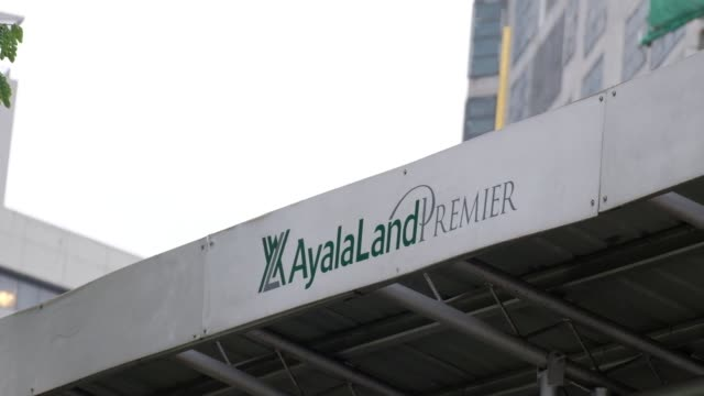 Signage for Ayala Land Premier is displayed outside the construction site of Garden Towers developed by Ayala Land Inc in the Makati district of...