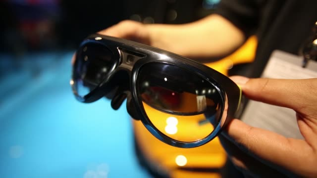stockvideo's en b-roll-footage met ms signage for bmw ag's mini augmented vision booth cs bmw ag's mini augmented vision headset designed to feed motorists information while their eyes... - goede staat
