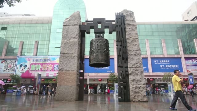 vídeos de stock, filmes e b-roll de signage for dong men is displayed in the pedestrianized dongmen area of shenzhen china on monday aug 4 a large bell stands in the pedestrianized... - household fixture