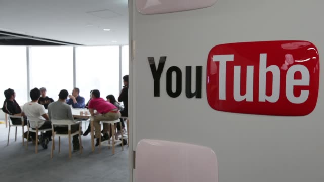 Signage for Google Inc YouTube Space studio is displayed on screens at the company facility in Tokyo as video creators participate in a workshop as...