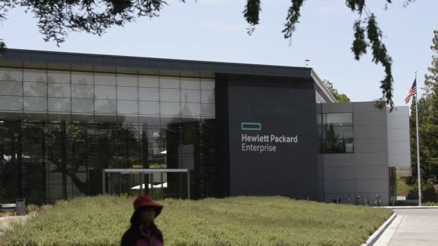 signage for hewlettpackard enterprise inc stands at the entrance to the company's headquarters in palo alto california us on monday may 23 2016 shots... - base stock videos & royalty-free footage