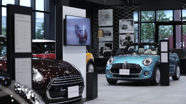 signage for mini manufactured by bayerische motoren werke ag is displayed outside a mini brand bmw group tokyo bay showroom in tokyo japan on monday... - 自動車ブランド mini点の映像素材/bロール