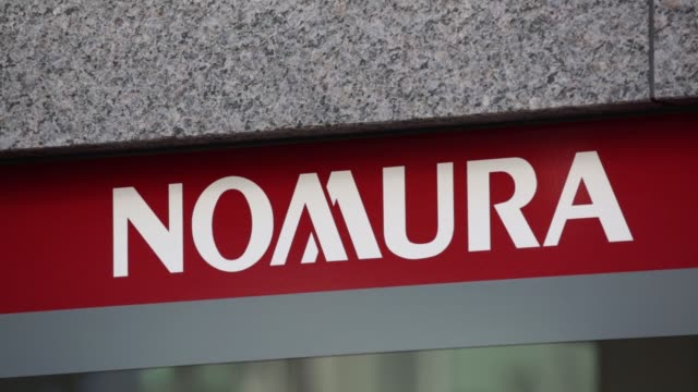 cs signage for nomura securities co is displayed outside one of the companys branches cs pan l r nomura logo ws signage for nomura securities co is... - 金融関係施設点の映像素材/bロール