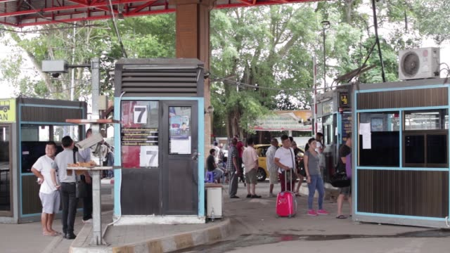 signage for sadao boundary post is displayed at the border checkpoint of sadao songkhla province thailand on friday oct 16 vehicles approach the... - songkhla province stock videos and b-roll footage