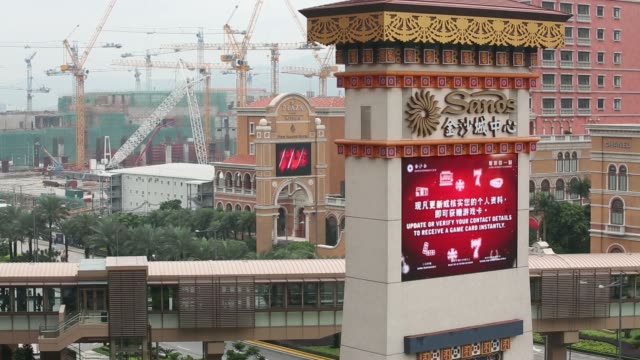 signage for sands cotai central casino resort pan from construction view of the parisian macao a unit of las vegas sands corp to signage for the... - cotai strip stock videos and b-roll footage