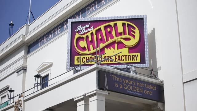Signage for the Charlie and the Chocolate Factory musical show sits above the entrance to the Theatre Royal Drury Lane in central London UK on...