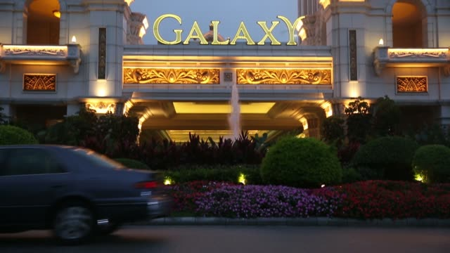 signage for the galaxy macau casino resort, operated by galaxy entertainment group ltd, stands illuminated at night in macau, china, on thursday, may... - macao stock videos & royalty-free footage