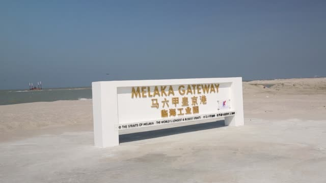 Signage for the Melaka Gateway development managed by Kal Development Sdn stands on a reclamation site operated by Power Construction Corp of China...