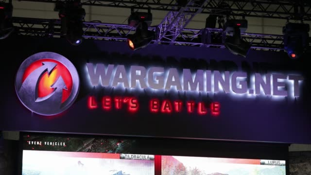 Signage for Wargamingnet is displayed above the booth at the Tokyo Game Show 2017 at Makuhari Messe in Chiba Japan on Friday Sept 22 Attendees play...