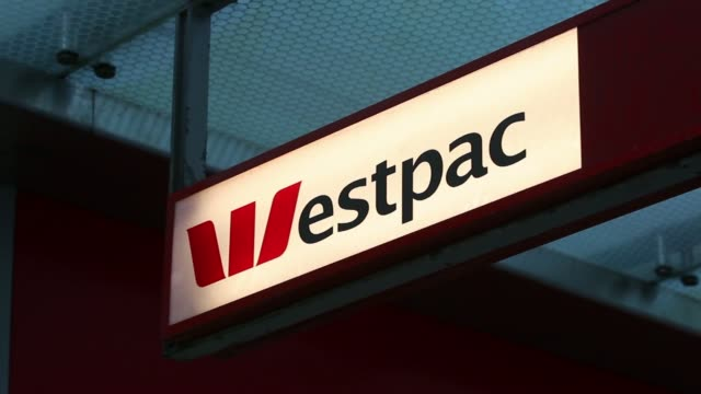 signage for westpac banking corp is displayed at one of the banks branches in sydney australia on wednesday april 30 2014 - banking stock videos & royalty-free footage