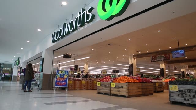 vídeos de stock, filmes e b-roll de signage for woolworths ltd is displayed atop of one of the company's supermarkets in sydney australia on thursday aug 27 2015 shots wide and medium... - woolworths