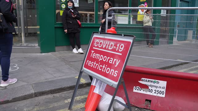 signage in old compton street, soho as restaurants cater for outdoor dinning as lockdown restricting ease on april 27, 2021 in london, united... - forbidden stock videos & royalty-free footage