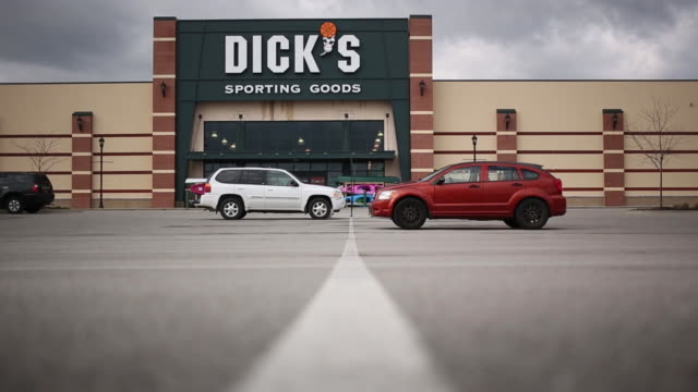Signage is displayed outside a DICK'S Sporting Goods Inc retail store in Frankfort Kentucky US on Wednesday March 7 2018 DICK'S Sporting Goods is...