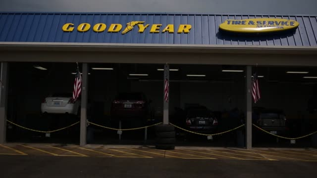 signage is displayed outside a goodyear auto service network location in shelbyville, kentucky, u.s. on monday, july 25, 2016 shots: full shot of... - chain object stock videos & royalty-free footage