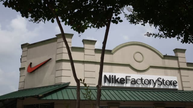 newest b7f61 f47d4 Signage is displayed outside a Nike Inc. retail store in New Orleans,...  Stock Footage Video - Getty Images