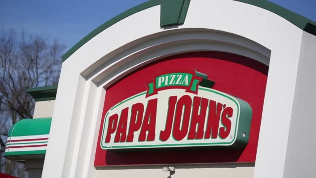 Signage is displayed outside a Papa John's International Inc pizza location in Nashville Tennessee US on Thursday Feb 9 2017 Shots