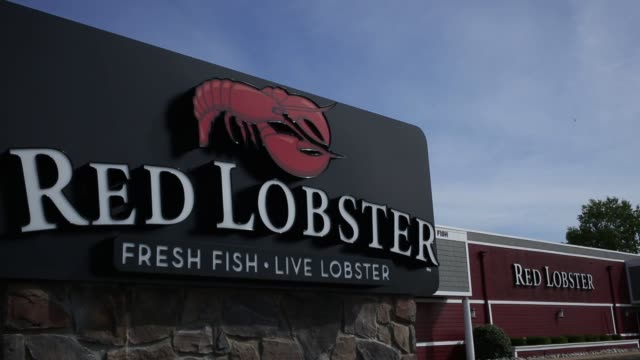 signage is displayed outside a red lobster restaurant in clarksville indiana us on monday june 22 2015 shots wide shots of the restaurant exteriors... - lobster stock videos and b-roll footage