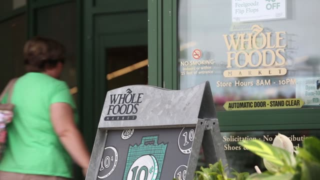 signage is displayed outside a whole foods market store in in naperville illinois us on friday june 16 2017 shots cu of signage above store wide pan... - whole foods market stock videos and b-roll footage