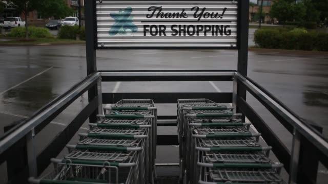 signage is displayed outside a whole foods market store in louisville kentucky us on sunday may 1 2016 shots wide shot of entrance to whole foods... - whole foods market stock videos and b-roll footage