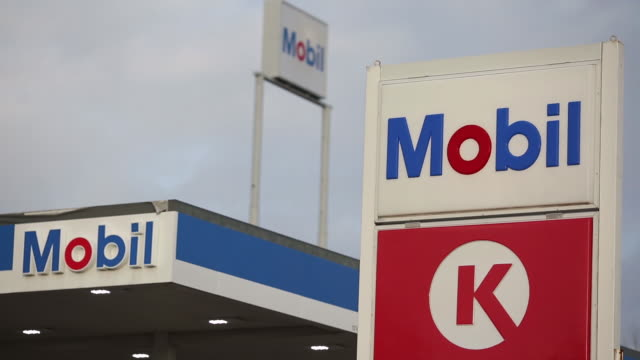 signage is displayed outside an exxon mobil corp gas station in columbus indiana us on tuesday jan 29 2019 - columbus indiana stock videos & royalty-free footage