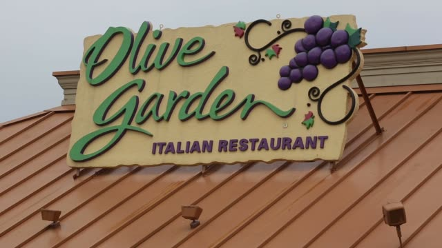 signage is displayed outside an olive garden restaurant in louisville kentucky us on monday june 22 - Olive Garden Louisville